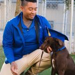Trainer looking at graduating dog